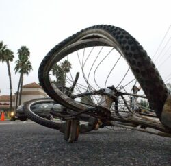 A bicycle came to rest in the southbound turn lanes of Rose Drive at Imperial Highway after its rider was struck by a Lexus ES 330. According to Placentia Police Sgt. Ken Alexander,  the cyclist was riding east out of a driveway at the Rose Imperial Plaza, between a Del Taco and a Flame Broiler restaurant, and began to cross the street about 50 yards north of the crosswalk at Imperial Highway. He rode into the path of the Lexus which was traveling southbound on Rose Drive.